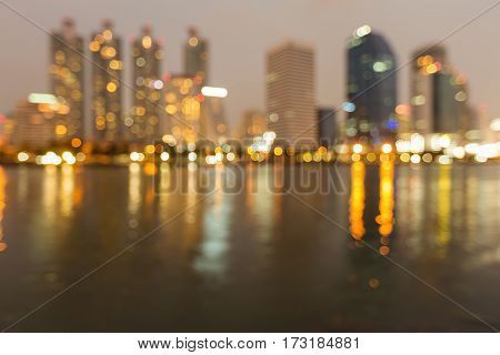 Blur light office building and reflection night view abstract background