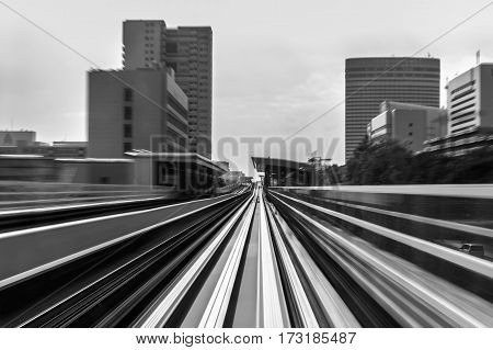 Black and White blur motion of mover train in to city downtown abstract background