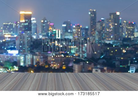 Opening wooden floor city blur light night view abstract background