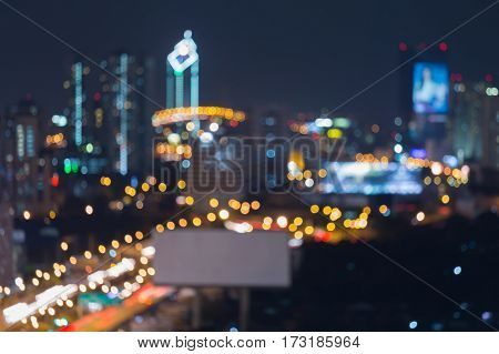 Night aerial view blurred bokeh lights city central business downtown abstract background