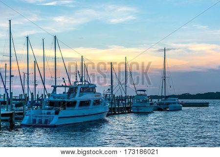 Panama City Beach, Florida, USA - July 11, 2015: Boats at the Panama City Marina docked with a sunset in the background.