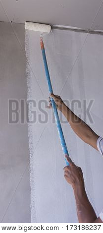 Panting white color on paster wall with paddle roller