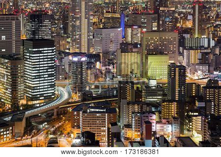 City office building night lights Osaka Japan