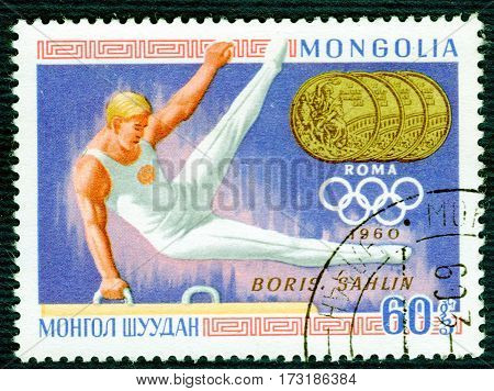 MONGOLIA - CIRCA 1960: Postage stamp printed in Mongolia  with a picture of Boris Sahlin (gymnastics), from the series