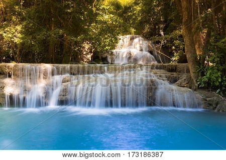 Blue stream waterfall in deep forest national park of Thailand natural landscape background