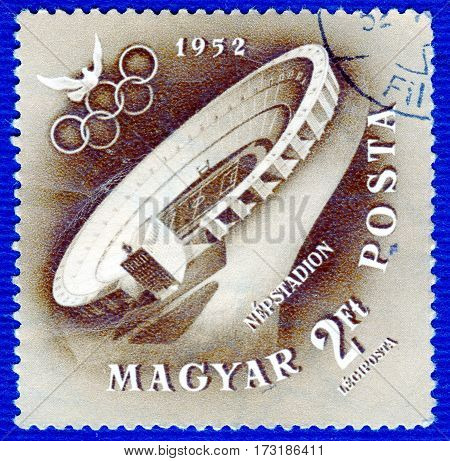 HUNGARY - CIRCA 1952: Postage stamp printed in Hungary  with a picture of a stadium where the event took place, from the series