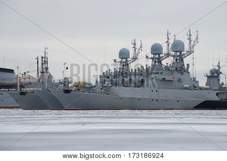 KRONSTADT, RUSSIA - JANUARY 25, 2017: Three small anti-submarine ship of the Baltic Navy on the winter Park, cloudy January day