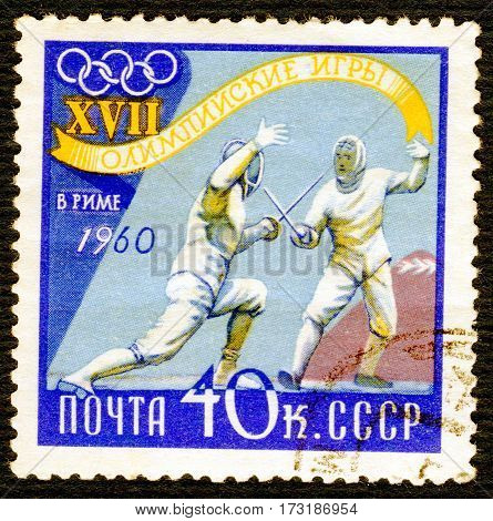 USSR - CIRCA 1960: Postage stamp printed in USSR  with a picture of a fencing, from the series