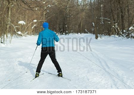 The Man On The Crosscountry Skiing In Winter Forest.