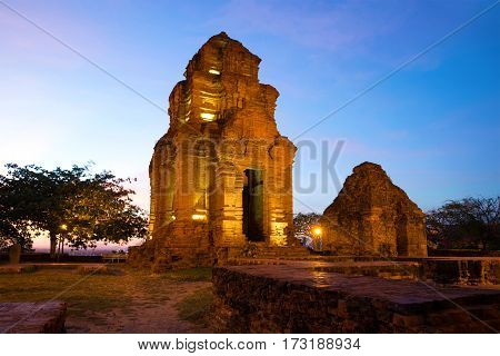 Two ancient Hindu temple (Cham towers) in the evening twilight. Phan Thiet, Vietnam
