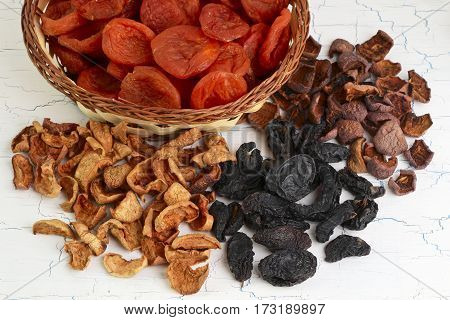 Dried fruits assortment on white background heaps