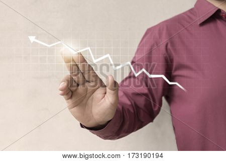 A businessman offering chart business diagram statistic Using modern technologies for business ./ Show through hand for support stock financial graph. Mixed media