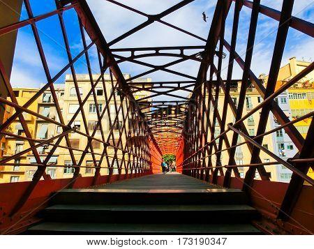 Iron bridge and coloured houses in Girona, Spain