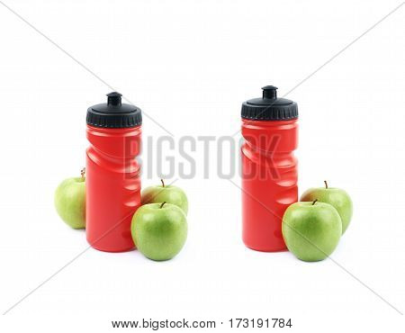 Composition of red plastic drinking bottle next to a pile of green apples, isolated over the white background, set of two different foreshortenings