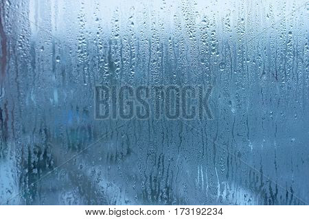 The Condensate In The Form Of Water Droplets On The Background Window. Window Glass With High Humidi
