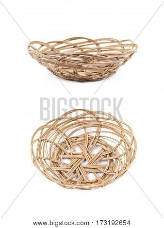 Empty wicker fruit basket isolated over the white background, set of two different foreshortenings