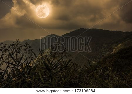Mountain Peaks With Sky And Beautiful Full Moon. Sepia Color.