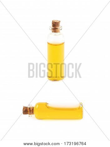 Single glass vial bottle with a cork filled with a colored liquid, isolated over the white background, set of two different foreshortenings