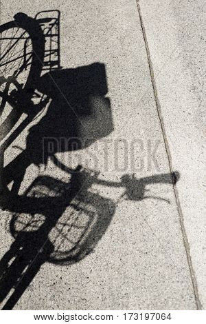 Shadow of cycle on a concrete road, backgrounds