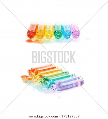 Set of multiple tiny glass vial bottles filled with the rainbow colored liquids, composition isolated over the white background, set of two different foreshortenings
