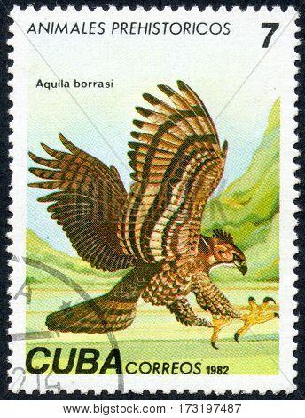 UKRAINE - CIRCA 2017: A stamp printed in Cuba shows a extinct bird hawk Aquila borrasi the series Prehistoric animals circa 1982