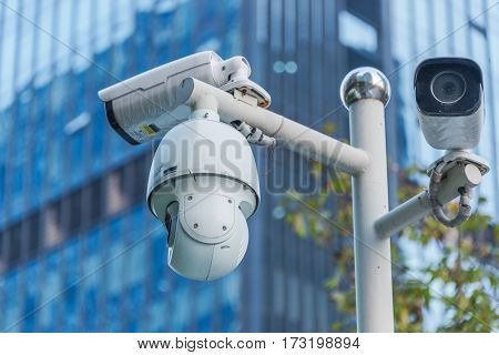 CCTV security camera front of a building in city of China.
