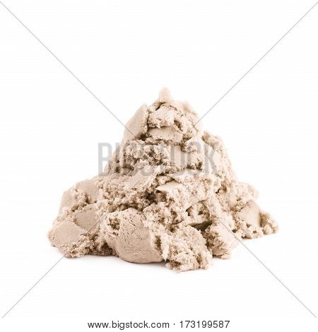 Pile of kinetic sand isolated over the white background