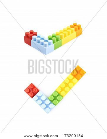 Yes tick mark made of plastic colorful construction toy bricks isolated over the white background, set of two different foreshortenings