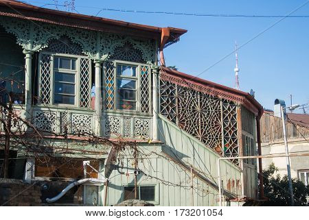 TBILISI GEORGIA - JANUARY 3 2016: Exterior of an old house with mosaic windows in the old town of Tbilisi Georgia.