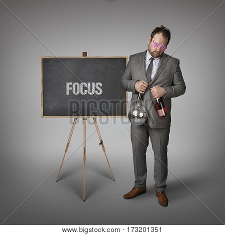 Focus partyman text on blackboard with businessman and key