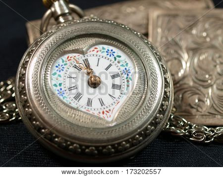 Antique silver watches with painted porcelain face