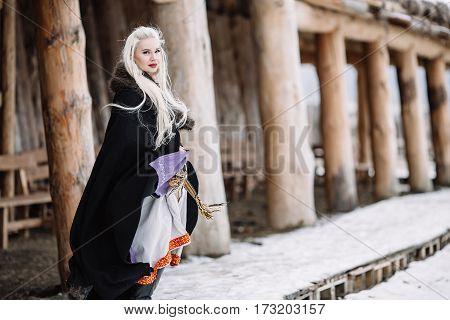 Beautiful girl viking historic figure black cloak