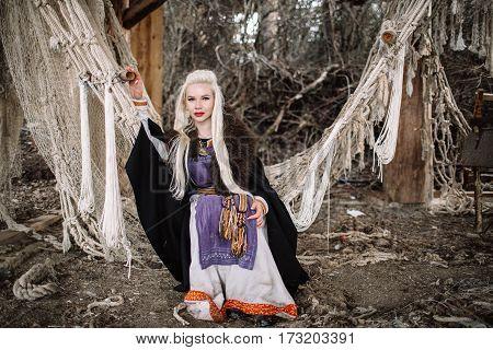 Portrait of a blond Viking in a fishing net