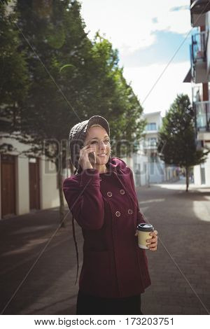 Woman talking on mobile phone in street