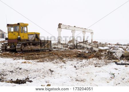 bulldozer on construction site job of burying the old building