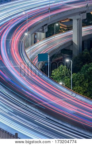 car trails on overpass in Shenzhen,high angle,China.