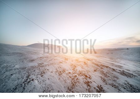 Snow-covered hillsides, Arctic mountain desert. Winter decline