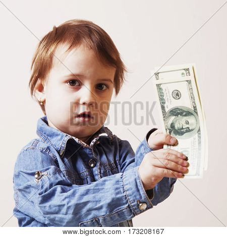 I love money! A child holding a bill dollars. (Success wealth happiness opportunity motivation) (Humorous picture)