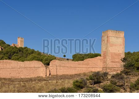 Medieval Town Walls Of Daroca And Jaque Tower, In The Background The Tower Of Sant Cristobal, Zarago