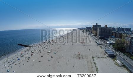 Cityscape with many people rest on Brighton Beach at summer sunny day. Aerial view