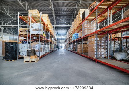 Warehouse industrial and logistics companies. The boxes on high shelves stocked. Toning the image.