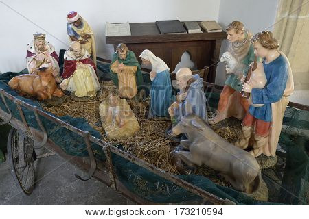 Nativity scene in old hay wagon St James Medieval Church Chuch End Charfield Gloucestershire