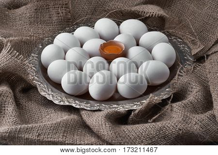 Ecological natural fresh eggs collected on a tray for cooking on the fabric.