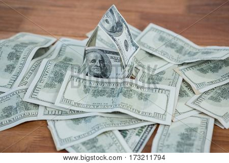 Close-up of dollar bank notes scattered on the table