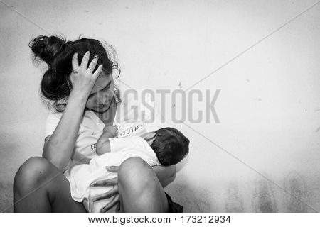 Teenage problem conceptSocial problemTeen women stress Teen have baby black and white tone