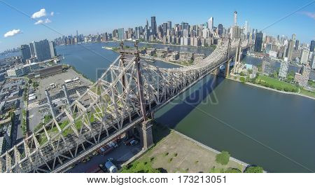 Queensboro Bridge at summer sunny day in New-York City. Aerial view