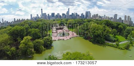 Central Park with Bethesda Terrace and Angel of the Waters fountain on shore of The Lake at summer day. Aerial panorama