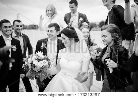 Zastavna, Ukraine - September 25, 2016: Wedding Couple With With A Crowd Of Friends Having Fun. Blac