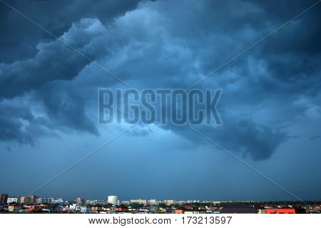 dark cloudy sky before the storm over the city