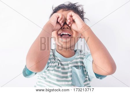 Cute asian little boy lying on floor and cry on white background